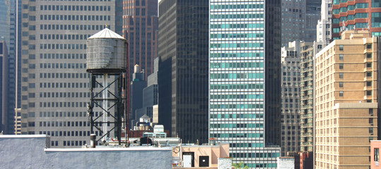 New York - Buildings in Manhattan with water tank roof