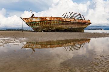 Shipwreck on a Beach with Blue Sky