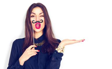 Winking model girl holding funny mustache on stick