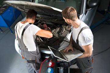 Mechanic team repair car
