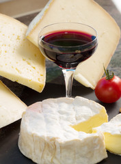 camembert cheese with a glass of wine