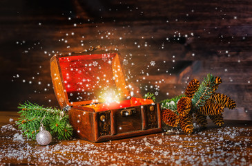 Christmas winter fairy with fantasy miracle in opened chest trea