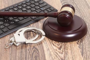 Computer keyboard,handcuffs and judge gavel