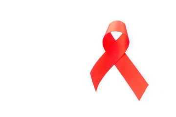 Hand hold red ribbon on white background for AIDs awareness concept