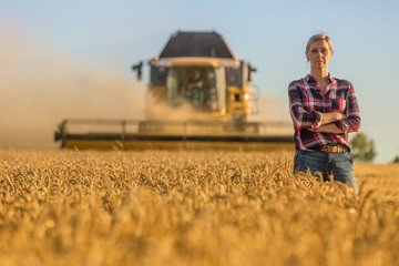female farmer and combine harvester