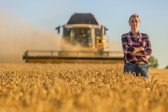 female farmer and combine harvester