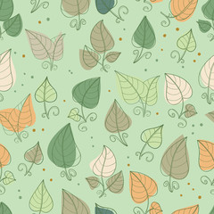 Seamless pattern of hand-drawn and colored leaves.Vector graphics .