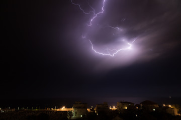 Lightning storm over the cemetery, sea and the city of Nahariya at night