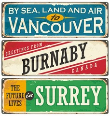 Retro tin sign collection with Canada cities