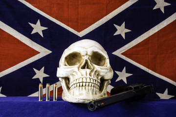 human skull on blue with three bullets and 357 magnum revolver with confederate flag background