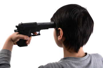 gun in hand pointing to head