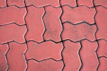 red cobblestone background,Stone paving texture. Abstract pavement background