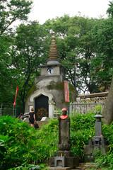 Jizo bodhisattva and a Buddhist stupa, Tokyo, Japan