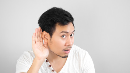 Asian man listen to something carefully. Asian man with surprise face.