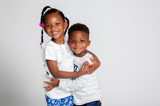Young African American Siblings Hugging