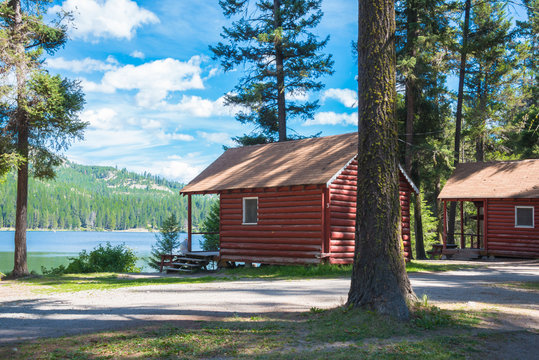 Rustic Log Cabins in Forest on Fishing Lake in a Resort Campground