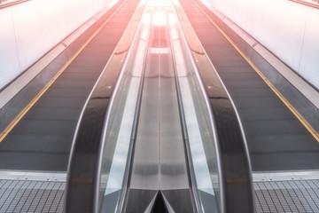 Modern walkway of escalator move forward and escalator move backward in international airport. Escalator is facility for support transportation in modern building