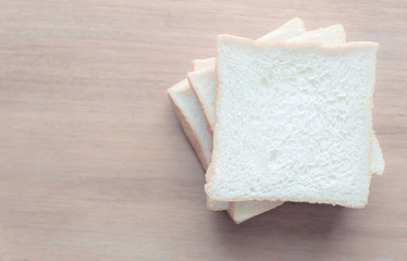 slice of bread on wooden table background