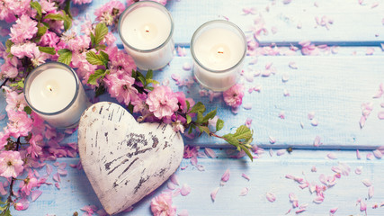 Background  with sakura  pink flowers, decorative heart  and can