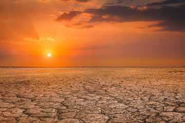 Stores photo Desert de sable Cracked earth soil sunset landscape