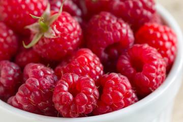 Fresh raspberries in round-shaped bowl, close view