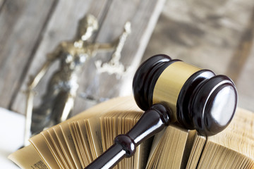 Law concept. Judge gavel, statue and book