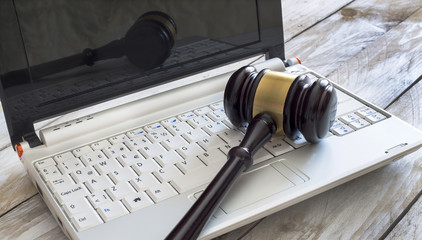 Law concept. Close up of judge gavel and laptop