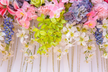 mix bunch flower backgdrop in wedding ceremony