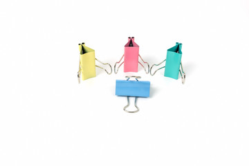 four colorful paper clip on white background
