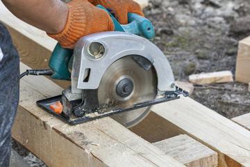 Work with circular saws closeup