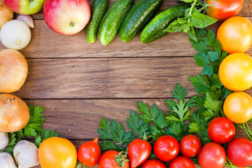 Frame of fresh vegetables on a wooden table. Top view, space for