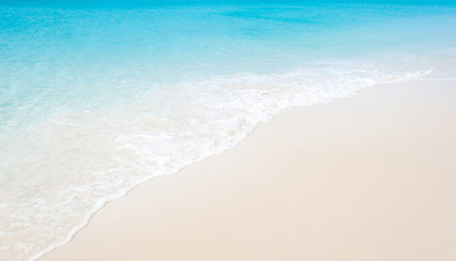 Tropical beach with coral white sand and calm wave