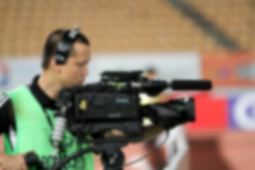 blurry of Professional cameraman and Video camera operator worki