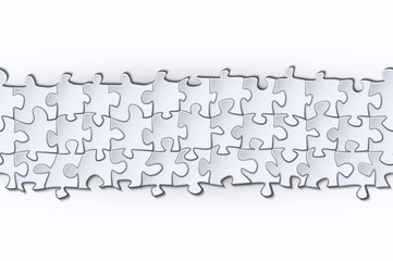 Horizontal strip of paper surround the elements of the puzzle on a white background