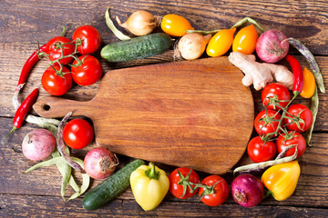 empty wooden board with vegetables for cooking