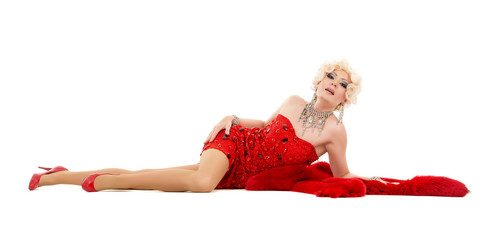 Drag Queen in Red Dress with Fur Lying on the Floor