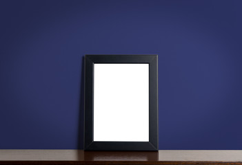 Black picture frame border on Navy classic background. Empty photo frame for your photo with dark blue wall.