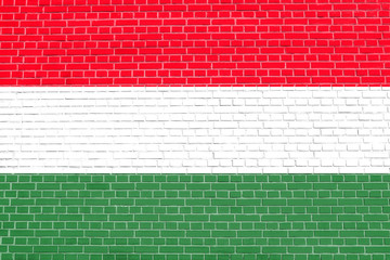 Flag of Hungary on brick wall texture background