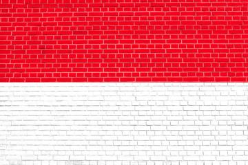 Flag of Indonesia, Monaco, Hesse (Germany) on brick wall