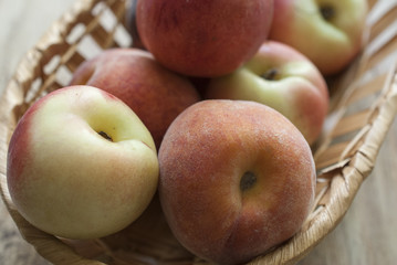 lay the peaches in a wicker basket