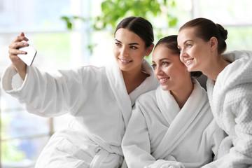 Beautiful girls taking selfie in spa salon