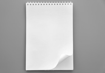 Blank notebook on grey background
