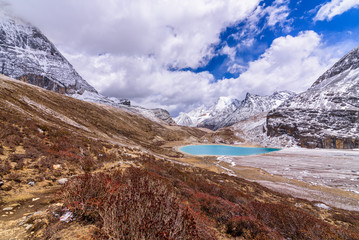 Milk lake on the snow mountains in Yading, China.