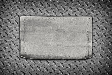 jeans labels on steel plate background