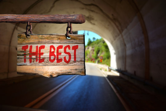 The best motivational phrase sign on old wood with blurred background
