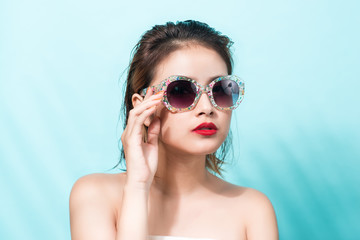 Colorful portrait of young attractive asian woman wearing sunglasses