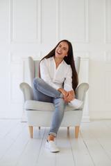 Close-up portrait of joyful and laughing softly female while sit