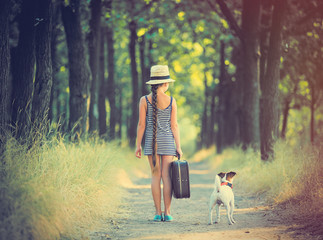 girl with suitcase and dog