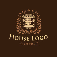 Logo emblem with the house.