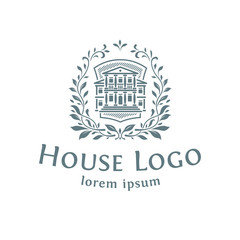 Emblem with the house. White background.